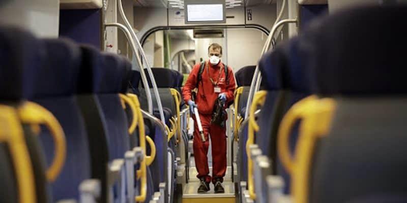 Worker sprays disinfectant on an Italian train.